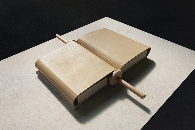 Ahmed Kamel - Artwork - With Us It's Different - Book, Leather, Paper and Concrete 52x60x7 cm (including stand: 80x100x120 cm), 2020